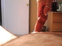 View of his cock while she strokes tubes