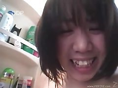 Japanese babe sucking cock in the bathroom tubes