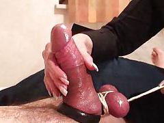 Tied up cock gets a handjob tubes