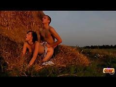 Teens having sex on a pile of hay tubes