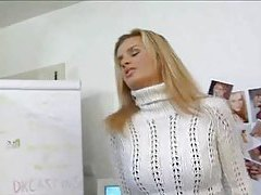 Girl in a sweater stretches and fucks tubes