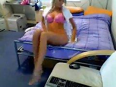 Blonde girl strips on webcam to masturbate tubes