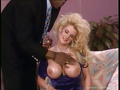 Big hair blonde slut takes black cock tube