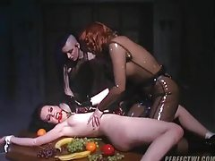 Girl tied to the table and groped by rubber chicks tubes