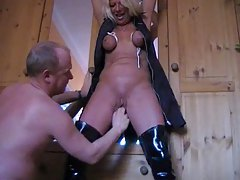 Wife in latex boots fisted in pussy tubes