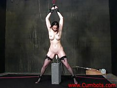 Dildo machine nails girl in bondage tubes