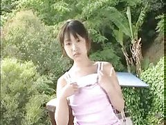 Teenage Japanese girl strips outdoors tubes