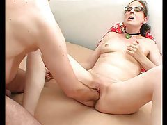 Mature in glasses has pussy stuffed with hand tubes
