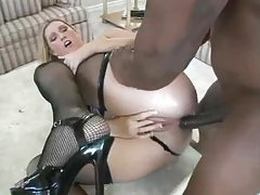 Hot white slut in black stockings goes ebony tubes