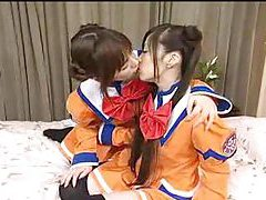 Japanese girls in costume kiss and play tubes