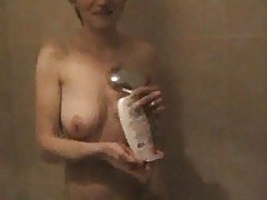 Cute girl showering in the nude tubes