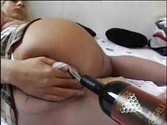 Drunken chick fucks her pussy with a bottle tubes