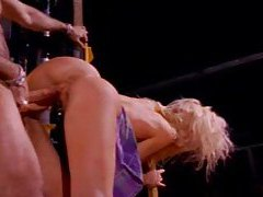 Busty hot blonde is fucked on heavy machinery tubes