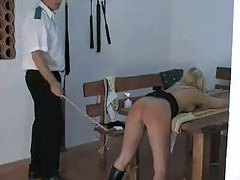 She is tied down and her ass is caned tubes