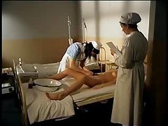 Nurses play while a man in a body cast watches tubes