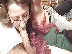 Milf in glasses slowly sucking cock tubes