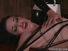 Girl tied down by her latex mistresses tubes