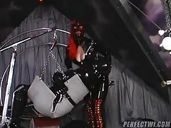 Chicks from head to toe in rubber in dungeon tubes