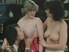 Girls try on lingerie and share cock in classic scene tubes