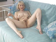 Lovely blonde mature entertaining with her body tubes