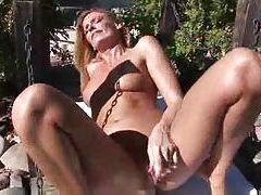 Pretty blonde pornstar outdoors using a toy tubes