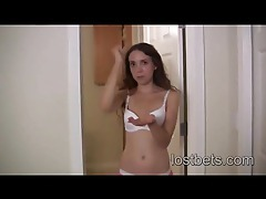 Cute girl taking her clothes off after losing tubes