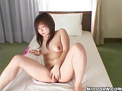 Japanese cutie masturbating for the camera tubes