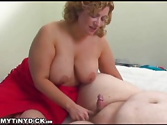 Fat girl makes fun of his tiny cock while blowing him tubes