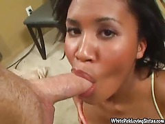 Busty black chick on her knees eating dick tubes