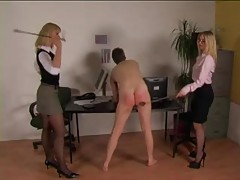 He gets spanked in the office by two babes tubes