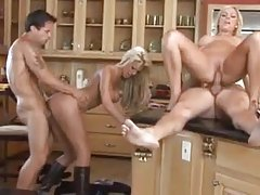 Couples wife swapping in the kitchen tubes