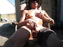 Mature masturbates in the warm sun tubes