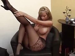 She puts on her pantyhose and dress tubes
