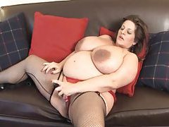 Fat mature in stockings fucks cunt with toy tubes
