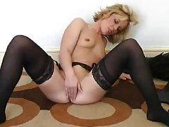 Small tits blonde in stockings toys her vagina tubes