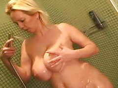 Fat girl takes a shower and rubs her body tubes