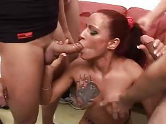 Inked up redhead in a big gangbang tubes