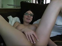 Cute amateur girl in glasses fucks ass with toy tubes