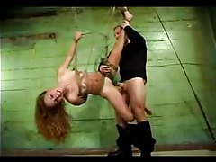 Redhead in extensive bondage is fucked tubes