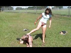 Girl kicks and beats on a guy outdoors tubes