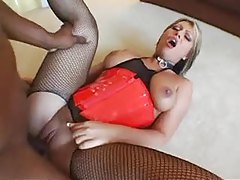 Big ass chick in latex corset goes black tubes