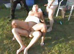 Three guys gangbang a cute blonde outdoors tubes