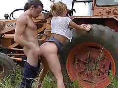 Busty babe gets fucked on a tractor tubes