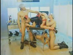 Latex nurse in a hardcore group scene tubes