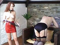 Redhead bangs her sissy in the ass with strapon tubes