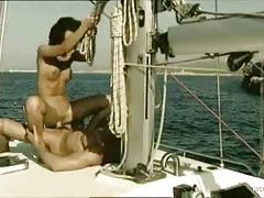 Dude with abs fucks sweaty slut on boat tubes