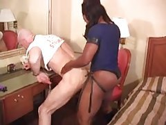 Older guy takes strapon from black chick tubes