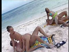 Two couples have sandy sex on the beach tubes