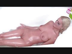 German babe takes a bath and sucks cock tubes