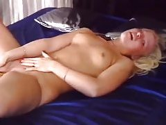 Cute young blonde with red fingernails toys tubes